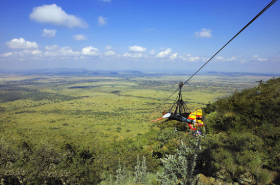 Speed over ravines on the longest, fastest Zip Slide in the world